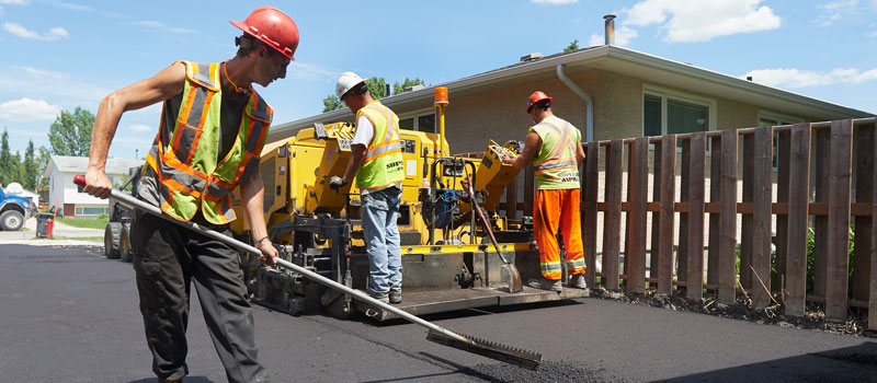 The Superior Asphalt team constructs a new residential driveway in Winnipeg